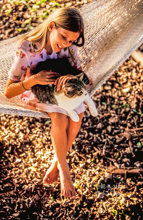 9 year old girl on hammock with her cat