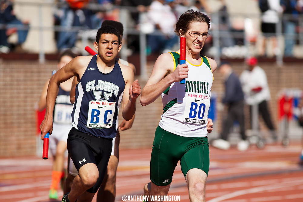 A member of the Damascus High School track team competes in the High School Boys' 4x400 at the 119th Penn Relays on Saturday, April 27, 2013 in Philadelphia, PA.
