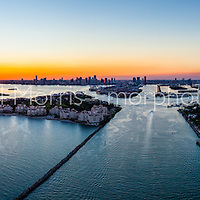Aerial panorama view of Miami Beach, South Point, waterfront and Government Cut, Port of Miami inlet at sunset. This version is watermarked, contact us to license and clean version.