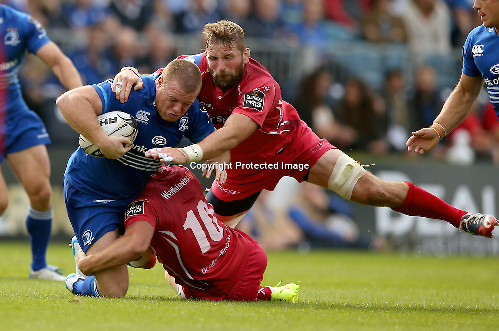 Guinness PRO12, RDS, Dublin 13/9/2014<br /> Leinster vs Scarlets<br /> Leinster&rsquo;s Sean Cronin is tackled by Scarlets Rhys Priestland and John Barclay<br /> Mandatory Credit &copy;INPHO/Billy Stickland
