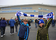 Young Brighton fans with scarves outside the American Express Community Stadium at the Sky Bet Championship match between Brighton and Hove Albion and Derby County at the American Express Community Stadium, Brighton and Hove, England on 2 May 2016. Photo by Phil Duncan.
