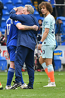Football - 2018 / 2019 Premier League - Cardiff City vs. Chelsea<br /> <br /> Cardiff City manager Neil Warnock consoles Aron Gunnarsson of Cardiff City watched by  David Luiz Moreira Marinho of Chelsea on the pitch after the game, at Cardiff City Stadium.<br /> <br /> COLORSPORT/WINSTON BYNORTH