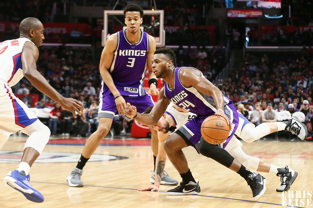 26 March 2016: Sacramento Kings guard Buddy Hield (24) drives past LA Clippers guard Austin Rivers (25) on a screen set by Sacramento Kings forward Skal Labissiere (3) during the Sacramento Kings 98-97 victory over the Los Angeles Clippers, at the Staples Center, Los Angeles, California, USA.