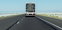 August 14, 2016 - Salt Lake City, Utah, U.S. -   A truck heading west of Salt Lake City on Interstate 80 displays a reminder about the dangers of texting while driving.(Credit Image: © Brian Cahn via ZUMA Wire)