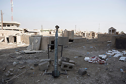 Licensed to London News Pictures. 23/10/2016. An Islamic State improvised rocket launcher stands in the vandalised grave yard at the Mart Shmony Church in Bartella, Iraq.<br /> <br /> Bartella, a mainly Christian town with a population of around 30,000 people before being taken by the Islamic State in August 2014, was captured two days ago by the Iraqi Army's Counter Terrorism force as part of the ongoing offensive to retake Mosul. Although ISIS militants were pushed back a large amount of improvised explosive devices are still being found in the town's buildings. Photo credit: Matt Cetti-Roberts/LNP