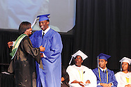 Principal Marlayna A. Randolph with graduate Andre Yates during the Paul Laurence Dunbar High School commencement in the Dayton Convention Center in downtown Dayton, Wednesday, May 23, 2012.