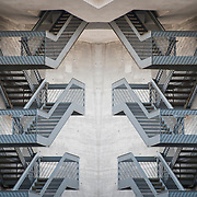 Photographic series of digital computer art from an image of exterior stairs<br /> <br /> Two or more layers were used to enhance, alter, manipulate the image, creating an abstract surrealistic mirrored symmetry.