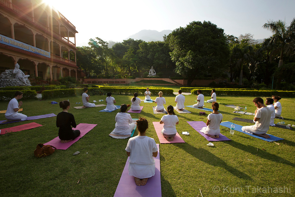 Guests take yoga class at Parmarth Niketan ashram in Rishikesh, India on June 4, 2014. Parmarth is among the ashrams that has delicately danced between extending its arms to foreign visitors while trying to preserve its Indian core. <br /> (Photo by Kuni Takahashi)