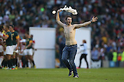 fan invades the pitch during the Rugby World Cup Pool B match between South Africa and Japan at the Community Stadium, Brighton and Hove, England on 19 September 2015. Photo by Phil Duncan.