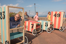 Community arts event Art Walk Porty got underway this afternoon with a promenade procession of the event's 'Art Carts'. The carts, designed to echo the old style bathing carts that used to grace Portobello beach, will be used in a variety of ways by different artists at locations across Portobello, Edinburgh's seaside suburb. The Art Walk is now in its third year and will run over the next day days with a range of events and exhibitions.  Pictured: Artists Karl Stern, Rosy Naylor, Jill Martin Boualaxai and Jenny Martin.<br /> <br /> <br /> <br /> &copy; Jon Davey/ EEm