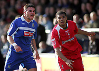 Photo: Paul Thomas.<br /> Stockport County v Swindon Town. Coca Cola League 2. 03/03/2007.<br /> <br /> Goal scorer Anthony Elding (L) of Stockport has a mouth full to say to Jerel Ifil.