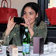 NLD/Laren/20130318 - Uitreiking Nannic Awards 2013, Hind Laroussi maakt foto met haar Iphone
