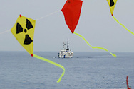"YELLOW ""STOP PLUTONIUM"" KITES, AND THE JAPANESE COAST GURAD SHIP THAT ESCORTED THE MVAS, JAPAN. 030702..PIC © JEREMY SUTTON-HIBBERT/GREENPEACE 2002..*****ALL RIGHTS RESERVED. RIGHTS FOR ONWARD TRANSMISSION OF ANY IMAGE OR FILE IS NOT GRANTED OR IMPLIED. CHANGING COPYRIGHT INFORMATION IS ILLEGAL AS SPECIFIED IN THE COPYRIGHT, DESIGN AND PATENTS ACT 1988. THE ARTIST HAS ASSERTED HIS MORAL RIGHTS. *******"