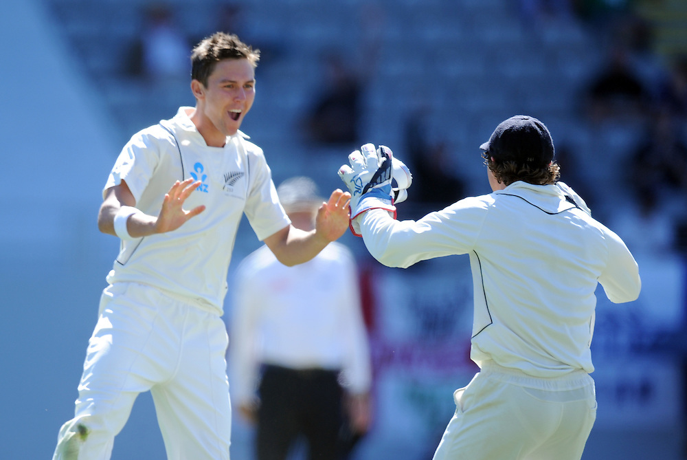 New Zealand's Trent Boult, left, celebrates with B J Watling after dismissing England's Joe Root lbw for 29 on the fifth day of the 3rd international cricket test, Eden Park, Auckland, New Zealand, Tuesday, March 26, 2013. Credit:SNPA / Ross Setford