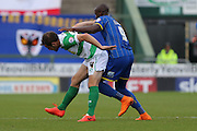 Tom Elliott of AFC Wimbledon battles Matt Dolan during the Sky Bet League 2 match between Yeovil Town and AFC Wimbledon at Huish Park, Yeovil, England on 12 September 2015. Photo by Stuart Butcher.