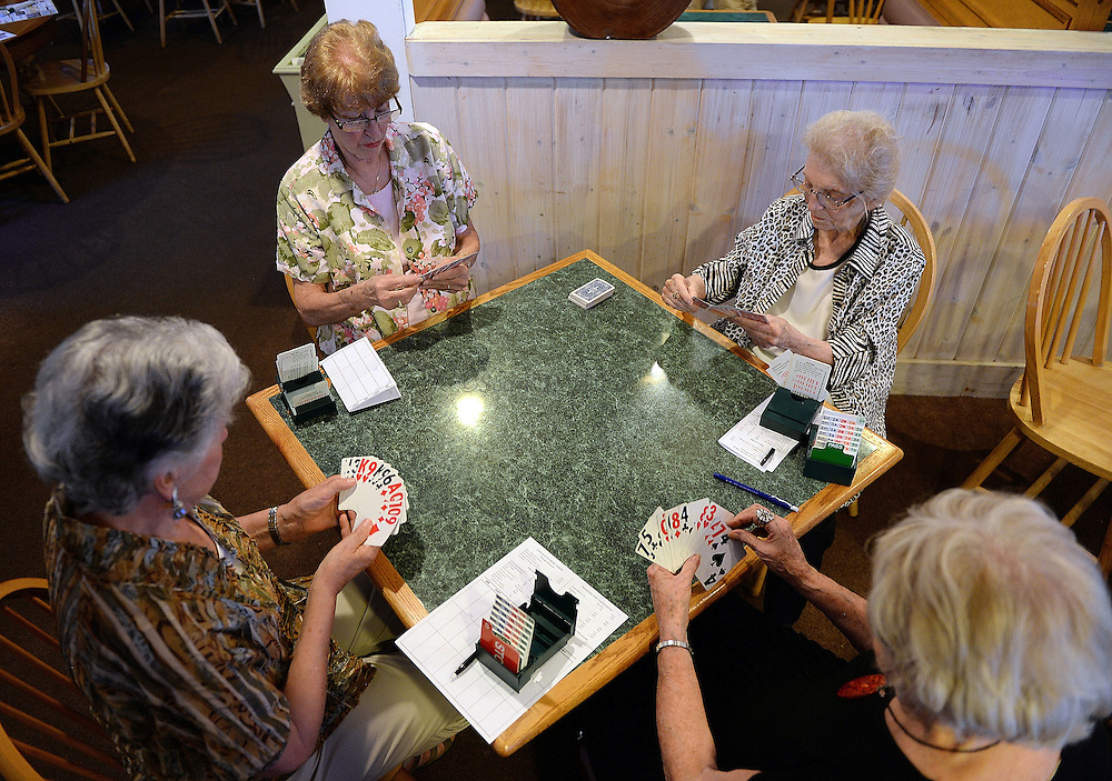 7/5/16 :: REGION :: BALDELLI :: Members of the Faire Harbor Bridge Club, from left, Christine Regan, Rosemary Dowsett, Genevieve Rafferty and Terry Vergeau plays their weekly game Tuesday, July 5, 2016 at The Lyme Tavern in Niantic. The club has been playing for over 100-years. (Sean D. Elliot/The Day)