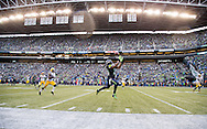 Seattle Seahawks running back Marshawn Lynch (24) looks for the ball in the air at the 2015 NFC Championship game between the Seattle Seahawks against the Green Bay Packers, on January 18, 2015 in Seattle, WA. (Tom Hauck/ AP Images)