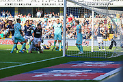 Millwall defender Shaun Hutchinson (4) scores a goal (1-1) during the EFL Sky Bet Championship match between Millwall and Queens Park Rangers at The Den, London, England on 21 September 2019.