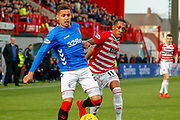 James Tavernier gets away from Mikel Miller during the Ladbrokes Scottish Premiership match between Hamilton Academical FC and Rangers at The Hope CBD Stadium, Hamilton, Scotland on 24 February 2019.