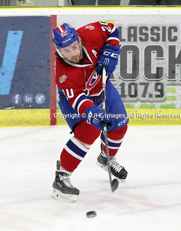 COBOURG, ON  - MAR 4,  2017: Ontario Junior Hockey League, playoff game between the Cobourg Cougars and the Kingston Voyageurs. Reed Kekewich #20 of the Kingston Voyageurs passes the puck during the third period.<br /> (Photo by Tim Bates / OJHL Images)