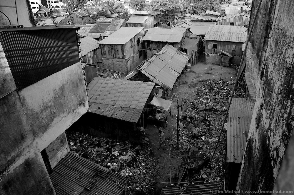"Life in a slum where the non governmental organization ""Acting for Women in Distressing Situations"" (AFESIP), conducts outreach and provides services in Phnom Penh, Cambodia. The permanent structure, a decaying four story building known simply as 'The Building', was built in the 1960's as transitional housing and now hosts a shantytown where many of the city's poor live, including many prostitutes, and is believed to have the highest rate of HIV infection in the city. AFESIP hands out free condoms, instructs prostitutes on HIV prevention, and conducts outreach in case the prostitutes need medical services, choose to leave their profession, or can report on cases of sex trafficking. AFESIP offers housing, education, training, and counseling for women who are victims of sex trafficking, worked as prostitutes, or are escaping domestic violence. Founded by Somaly Mam, who herself was once a prostitute and victim of trafficking and domestic abuse, AFESIP has three facilities in Cambodia and works with other NGO's to provide long term care for the women."
