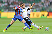 Legia's Orlando Sa (R) fights for the ball with Keith Fahey of St Patrick's during Second qualifying round UEFA Champions League soccer match between Legia Warsaw and St. Patrick's Athletic at Pepsi Arena in Warsaw, Poland.<br /> <br /> Poland, Warsaw, July 16, 2014<br /> <br /> Picture also available in RAW (NEF) or TIFF format on special request.<br /> <br /> For editorial use only. Any commercial or promotional use requires permission.<br /> <br /> Mandatory credit:<br /> Photo by &copy; Adam Nurkiewicz / Mediasport