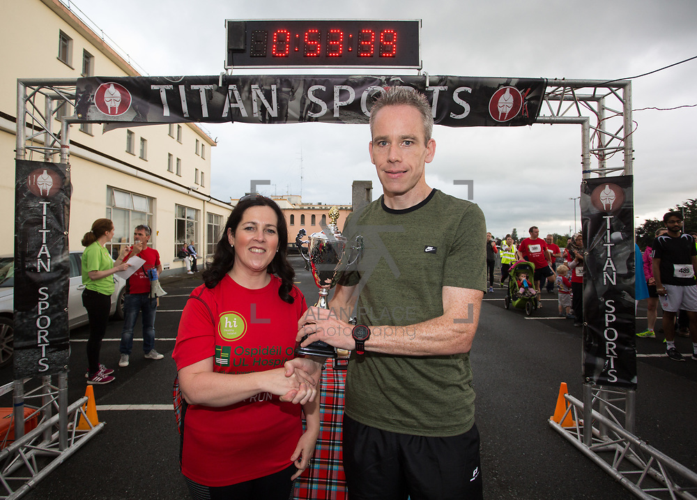 25.08. 2017.                                                      <br /> Almost 200 UL Hospitals Group staff, past and present, and members of the public completed the annual 5k Charity Run/Walk on Friday August 25th in Limerick.<br /> <br /> Suzanne Dunne, Head of Strategy presents the 2nd Place trophy to Garry Egan, An Bru A.C..<br /> <br /> <br /> Everybody who participated also raised funds for Friends of Ghana, an NGO formed last year by UL Hospitals Group and its academic partner the University of Limerick to deliver medical training programmes in the remote Upper West Region of Ghana. Picture: Alan Place