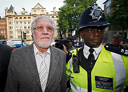© London News Pictures. 03/10/2013 . London, UK.   Radio DJ DAVE LEE TRAVIS (pictured left, also known as David Patrick Griffin) arriving at Westminster Magistrates court in London where he is charged with two counts of indecent assault on a woman aged over 16 between 1992 and 1993. Travis has already appeared in court to face the original 12 charges, which include indecent assault and sexual assault. Photo credit : Ben Cawthra/LNP