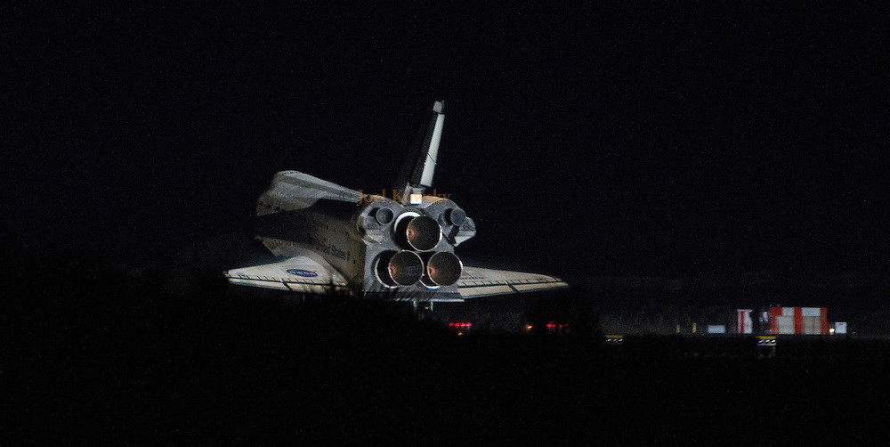 Cape Canaveral, Florida US - Space shuttle Atlantis lands on runway 16 at the Shuttle Landing Facility at the  Kennedy Space Center in the early morning hours of July 21, 2011.  Atlantis has logged 307 days in space and almost 126 million miles during her 33 flights.