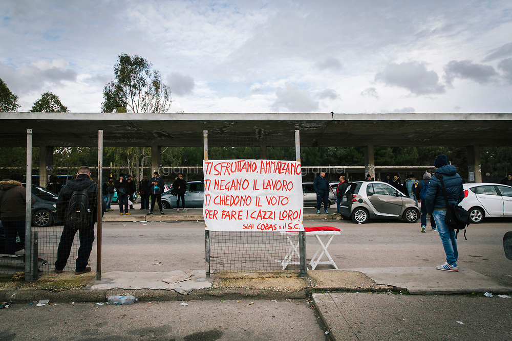 TARANTO, ITALY - 22 FEBRUARY 2018: <br /> A banner saying: &quot;No health, no job? No vote&quot; is seen here at the entrance of the ILVA steel mill in Taranto, Italy, on February 22nd 2018.<br /> <br /> Taranto, a  formerly lovely town on the Ionian Sea has for the last several decades been dominated by the ILVA steel mill, the largest steel plant in Europe. It was built by the government in the 1960s as a means of delivering jobs to the economically depressed south, but has been implicated for a cancer as dioxin and mercury have seeped into local groundwater, tainting the food supply, while poisoning the bay and its once-lucrative mussels.