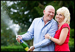 File Picture. Euro Millions Lottery winners Dave and Angela Dawes from Wisbech, Cambridgeshire, United Kingdom, celebrate winning £101,203,600.70 in the Euro Millions  Lottery in October 2011. It has been reported in Sunday newspapers that the Lottery couple are rumoured  to have split up. File Picture October 11th 2011. Picture by i-Images