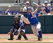 Jayhawk Preston Land drives a base hit to left center field agaisnt Kansas State.  The Wildcats held on to beat Kansas 5-4 at Tointon Stadium in Manhattan, Kansas, April 23, 2006.