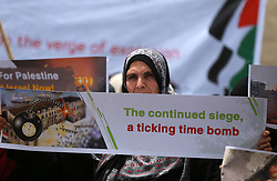 April 30, 2019 - Gaza City, Gaza Strip, Palestinian Territory - Palestinian protesters hold banners during a protest against the Israeli siege on Gaza Strip, in front of United Nations Development Programme office (UNDP), in Gaza City, on April, 30, 2019  (Credit Image: © Ashraf Amra/APA Images via ZUMA Wire)
