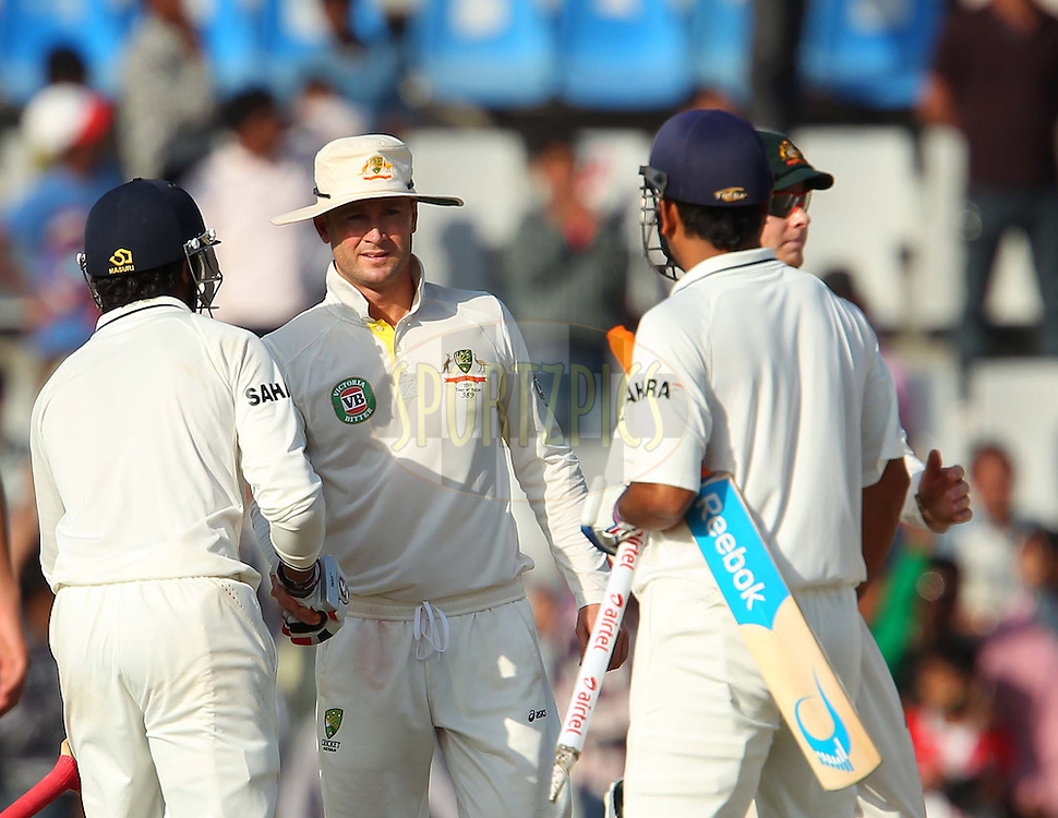 Michael Clarke Captain of Australia shakes hands with Ravindra Jadeja of India and MS Dhoni of India after the match during day 5 of the 3rd Airtel Test Match between India and Australia held at the PCA Stadium, Mohali, India on the 18th March 2013..Photo by Ron Gaunt/BCCI/SPORTZPICS ..Use of this image is subject to the terms and conditions as outlined by the BCCI. These terms can be found by following this link:..http://www.sportzpics.co.za/image/I0000SoRagM2cIEc