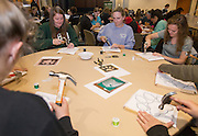From left: Stevi Miller, Renee Dubuc, and Katie Brodzeller create Ohio University-themed string art pieces during a Homecoming how-to event hosted by the Campus Involvement Center in Baker Center Theater Lounge on Oct. 7, 2014. Photo by Lauren Pond