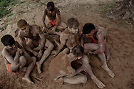 Group of Kushti wrestlers massaging a fellow wrestler after his practice, Varanasi, India