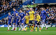 Branislav Ivanovic of Chelsea and Stephen Dawson of Scunthorpe United lead out their teams during the The FA Cup match between Chelsea and Scunthorpe United at Stamford Bridge, London, England on 10 January 2016. Photo by Ken Sparks.