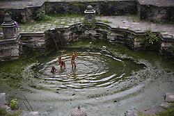 August 1, 2018 - Kathmandu, Nepal - Boys swim in rainwater inside an ancient water spout in Kathmandu, Nepal. (Credit Image: © Skanda Gautam via ZUMA Wire)