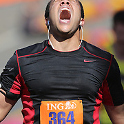 The Finish Line. Expressions of agony and ecstasy on the faces of athletes as D J Elliott, Patterson, New York, finishes the ING Hartford Marathon, Bushnell Park, Hartford. Connecticut. USA. Hartford, Connecticut, USA. 12th October 2013. Photo Tim Clayton