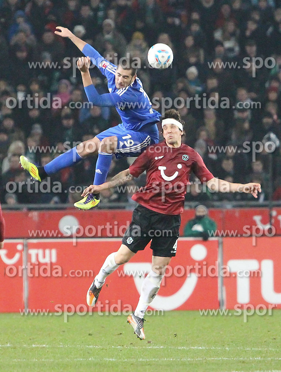 10.12.2011, AWD Arena, Hannover, GER, 1.FBL, Hannover 96 vs Bayer 04 Leverkusen, im Bild Eren Derdiyok #19 gegen Emanuel Pogatetz #4. // during the Match GER, 1.FBL, Hannover 96 vs Hamburger SV,  AWD Arena, Hannover, Germany, on 2011/12/10,.Foto © nph /Rust..***** ATTENTION - OUT OF GER, CRO *****
