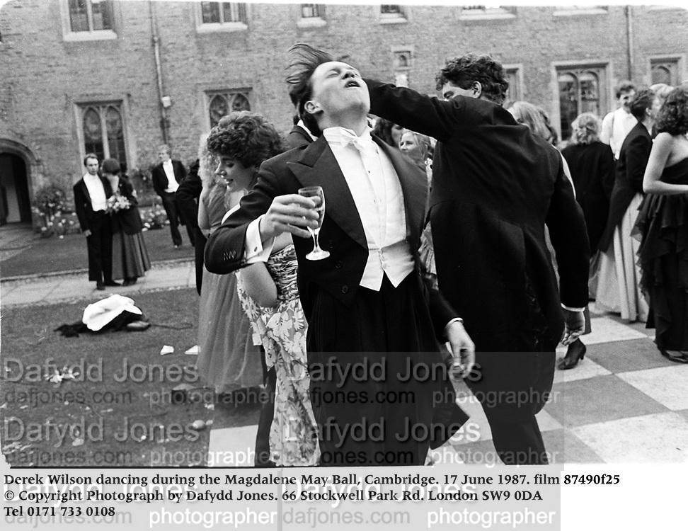 Derek Wilson dancing during the Magdalene May Ball, Cambridge. 17 June 1987. film 87490f25<br />© Copyright Photograph by Dafydd Jones<br />66 Stockwell Park Rd. London SW9 0DA<br />Tel 0171 733 0108