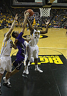 January 12 2010: Iowa Hawkeyes guard Bryce Cartwright (24) pulls in a rebound during the first half of an NCAA college basketball game at Carver-Hawkeye Arena in Iowa City, Iowa on January 12, 2010. Northwestern defeated Iowa 90-71.