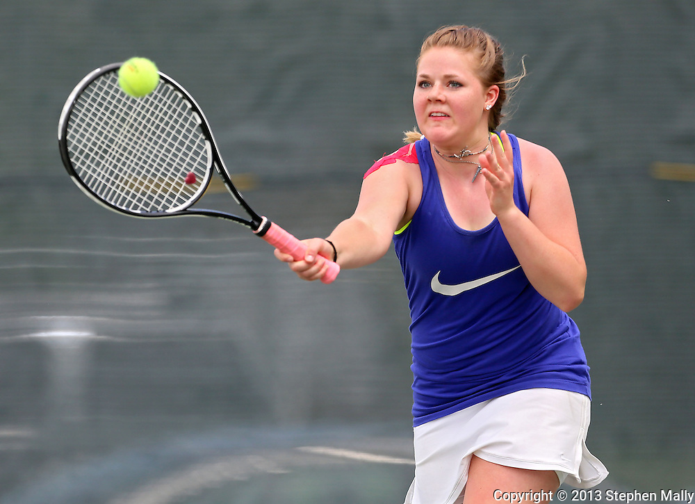 Urbandale's Madeline Heer returns the ball during a doubles match in the Class 2A state team tennis tournament at Veterans Memorial Tennis Center in Cedar Rapids on Saturday, June 1, 2013.