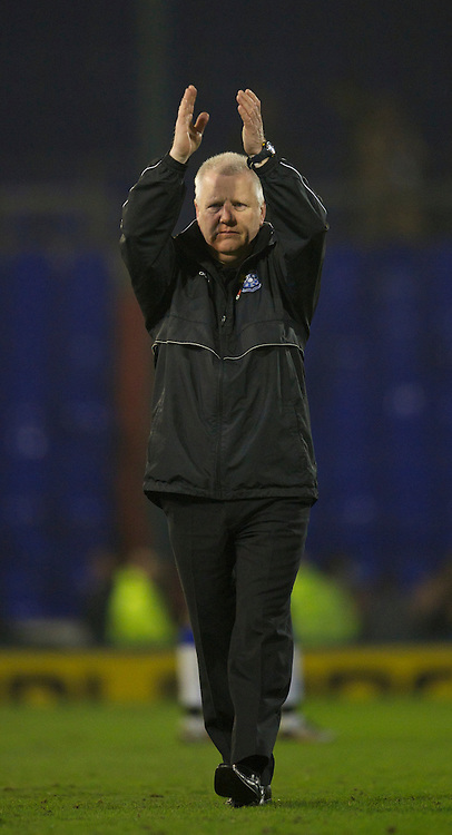OLDHAM, ENGLAND - Monday, March 28, 2011: Tranmere Rovers' manager Les Parry applauds the travelling supporters after the goal-less draw with Oldham Athletic during the Football League One match at Boundary Park. (Photo by David Rawcliffe/Propaganda)