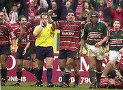 © Peter Spurrier/ Intersport Images.Photo Peter Spurrier.01/03/2003 Sport - Semi final Powergen Cup Rugby -.Leicester  v Gloucester - Franklin Gardens.Referee Steve Lander blow's for time as the Gloucester players start the celebrating..