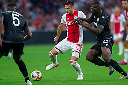 13-08-2019 NED: UEFA Champions League AFC Ajax - Paok Saloniki, Amsterdam<br />  Ajax won 3-2 and they will meet APOEL in the battle for a group stage spot / Dusan Tadic #10 of Ajax, Anderson Esiti #24 of PAOK