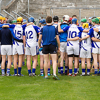 Kilmaley receiveing a final team talk from their Manager Niall Romer from behind the fence before their Minor A Hurling final