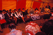 Funeral of a 29-year-old woman (a neighbor of the Qampies) in Soweto, South Africa. The funeral is in a tent set up on the street outside the family's home in the sprawling area of Southwest Township (called Soweto), outside Johannesburg (Joberg) South Africa. Material World Project.