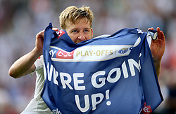 Fulham's Tim Ream celebrates promotion after the final whistle during the Sky Bet Championship Final at Wembley Stadium