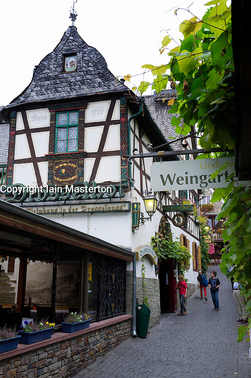 Famous tourism Drosselgasse Street in popular town of Rudesheim on River Rhine in Germany